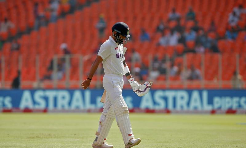 India's captain Virat Kohli walks off the field after his dismissal. — Reuters