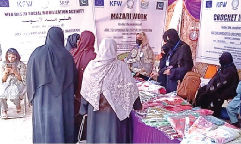 Visitors at a stall of the exhibition held in Kohat on Friday. — Dawn