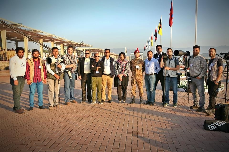Saadia Sehar Haidari poses for a group photo along with male photographers after an official assignment.