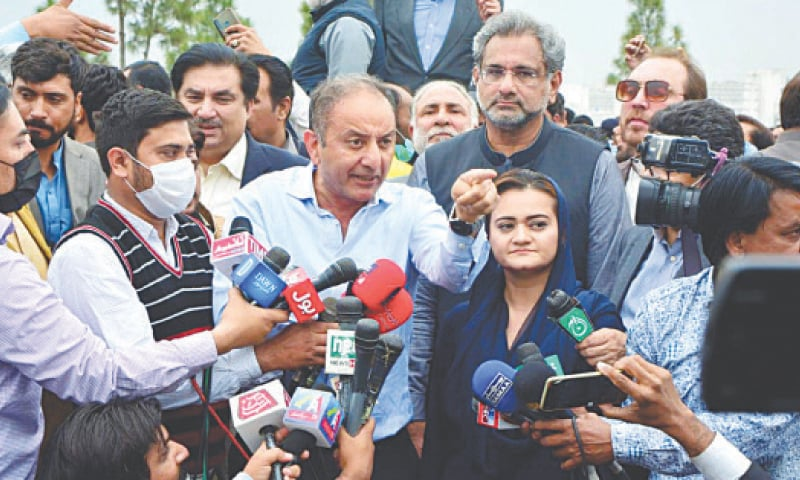 PML-N leader Musadiq Malik gestures as he speaks to journalists outside the Parliament House after a clash with PTI supporters on Saturday. Shahid Khaqan Abbasi, Marriyum Aurangzeb and Khurram Dastagir are also seen.—Mohammad Asim / White Star