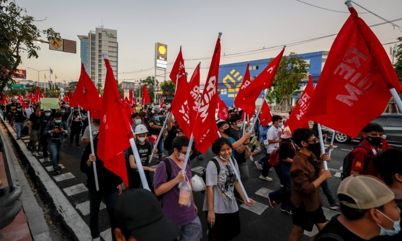 Anti-government protesters march to the criminal court during a protest in Bangkok, Thailand on Saturday. — AP