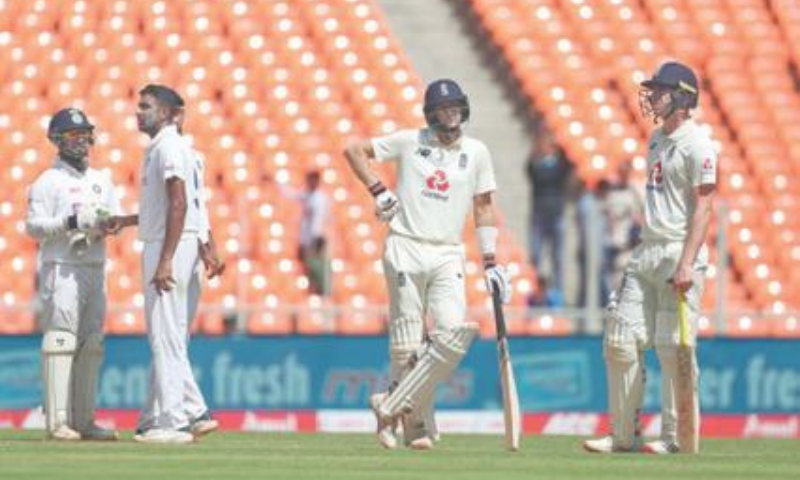 AHMEDABAD: England captain Joe Root (second R) awaits third umpire's decision before he is given out to India spinner Ravichandran Ashwin (second L) during the fourth Test on Saturday. — AP