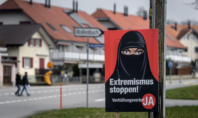 """A campaign poster, in favour of the """"burqa ban"""" initiative reading in German: """"Stop extremism!"""" is seen in Biberen near Bern on Sunday. — AFP"""