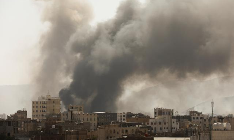 Smoke billows from the site of Saudi-led air strikes in Sanaa, Yemen, March 7. — Reuters
