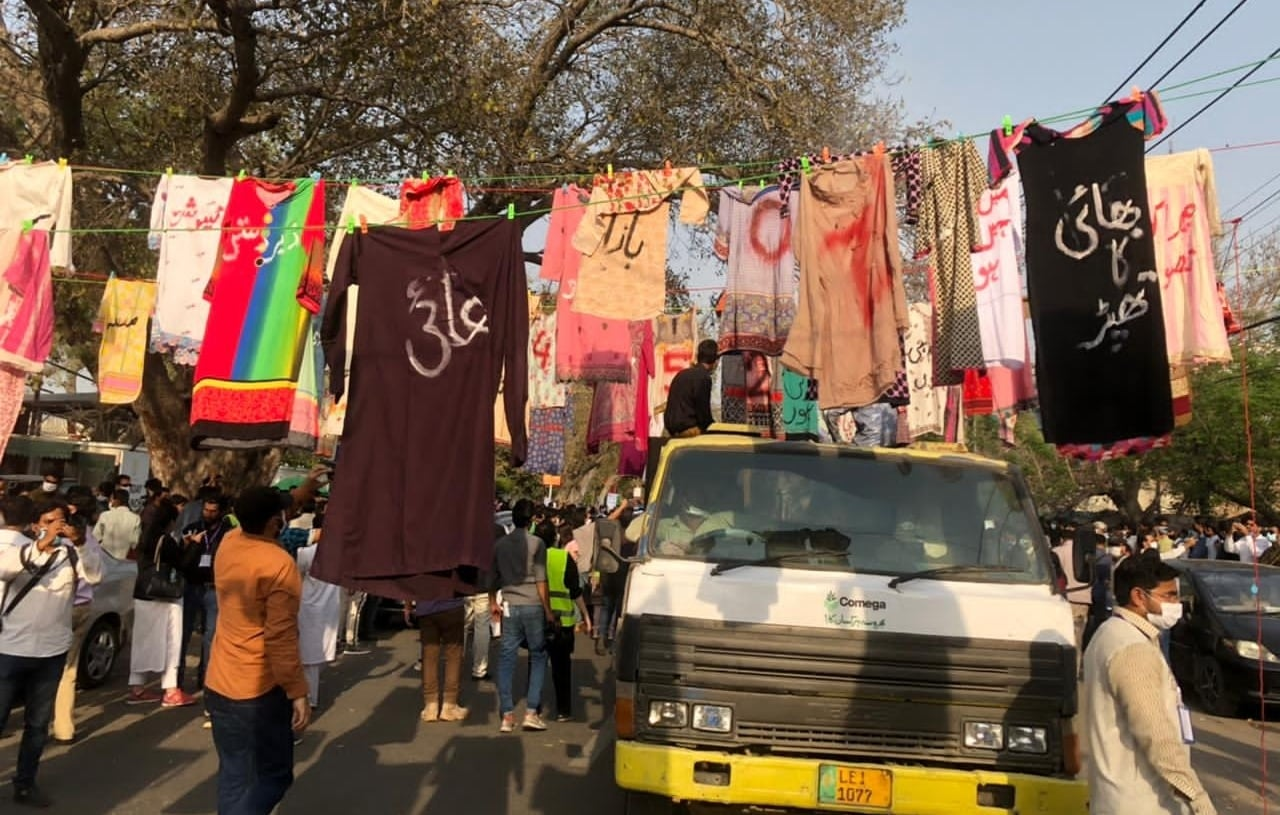 Clothes are hung as part of an art display in Lahore. — Photo: Imran Gabol