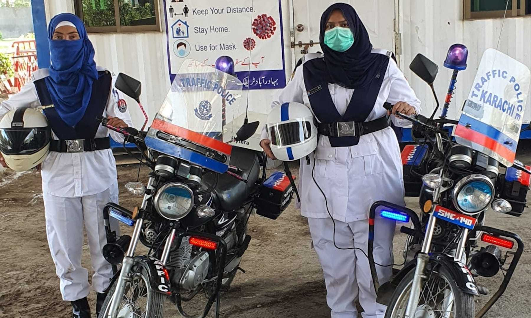 Traffic police constables Sumaiya and Razia who were deployed as patrolling motorcycle riders pose for a photo. — Photo courtesy Traffic Police Department