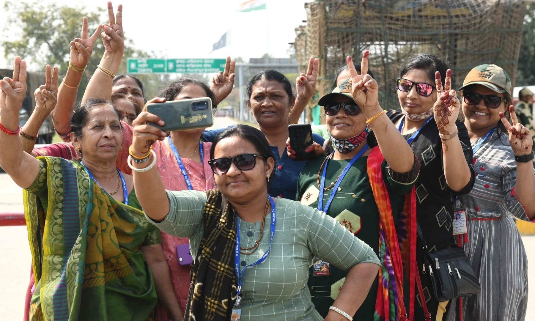 Tourists take selfies on the occasion of International Women's Day outside the entrance of the India-Pakistan Wagah Border post, about 35km from Amritsar on March 8. — AFP