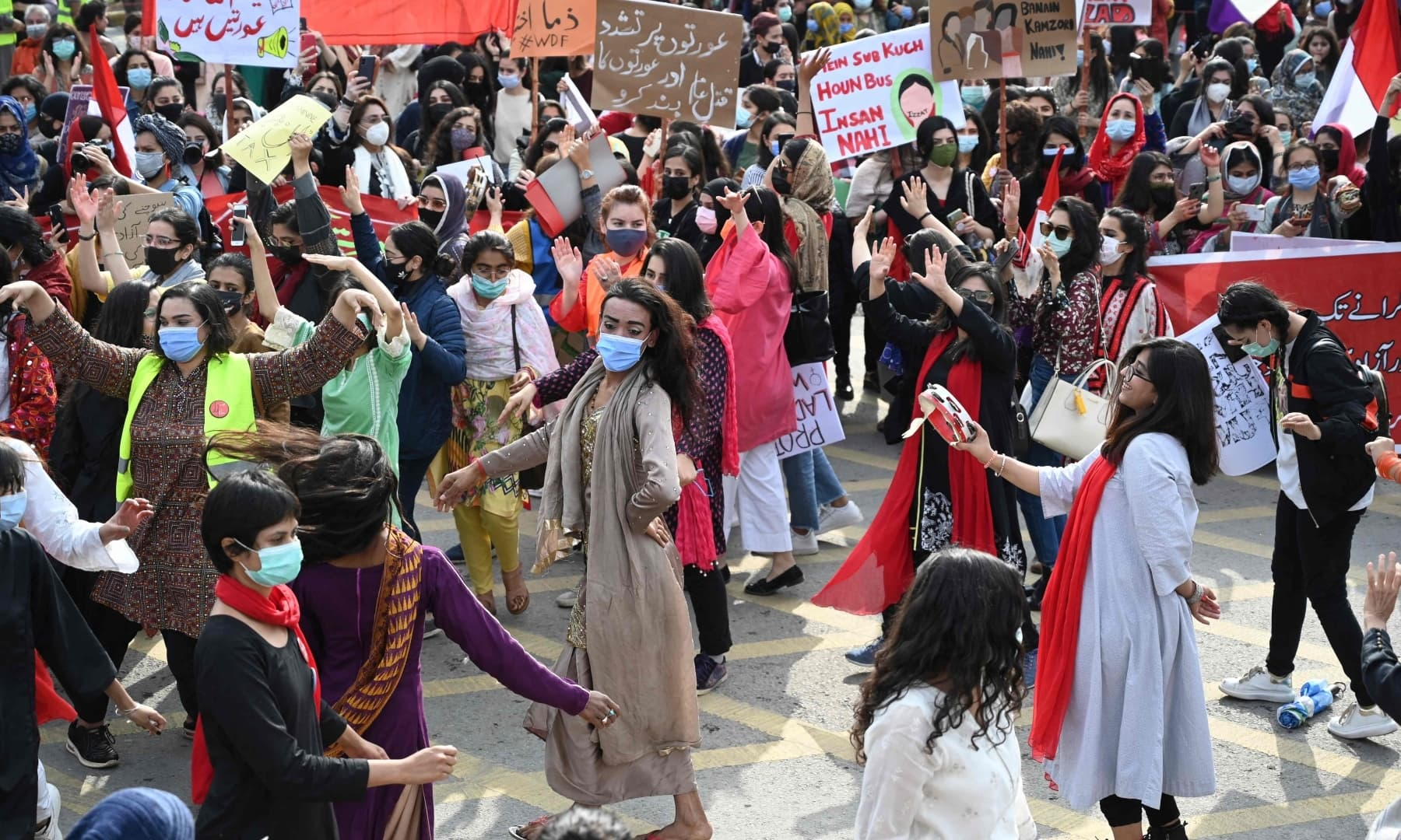 Participants of the Aurat March dance during a rally to mark the International Women's Day in Islamabad on March 8. — AFP