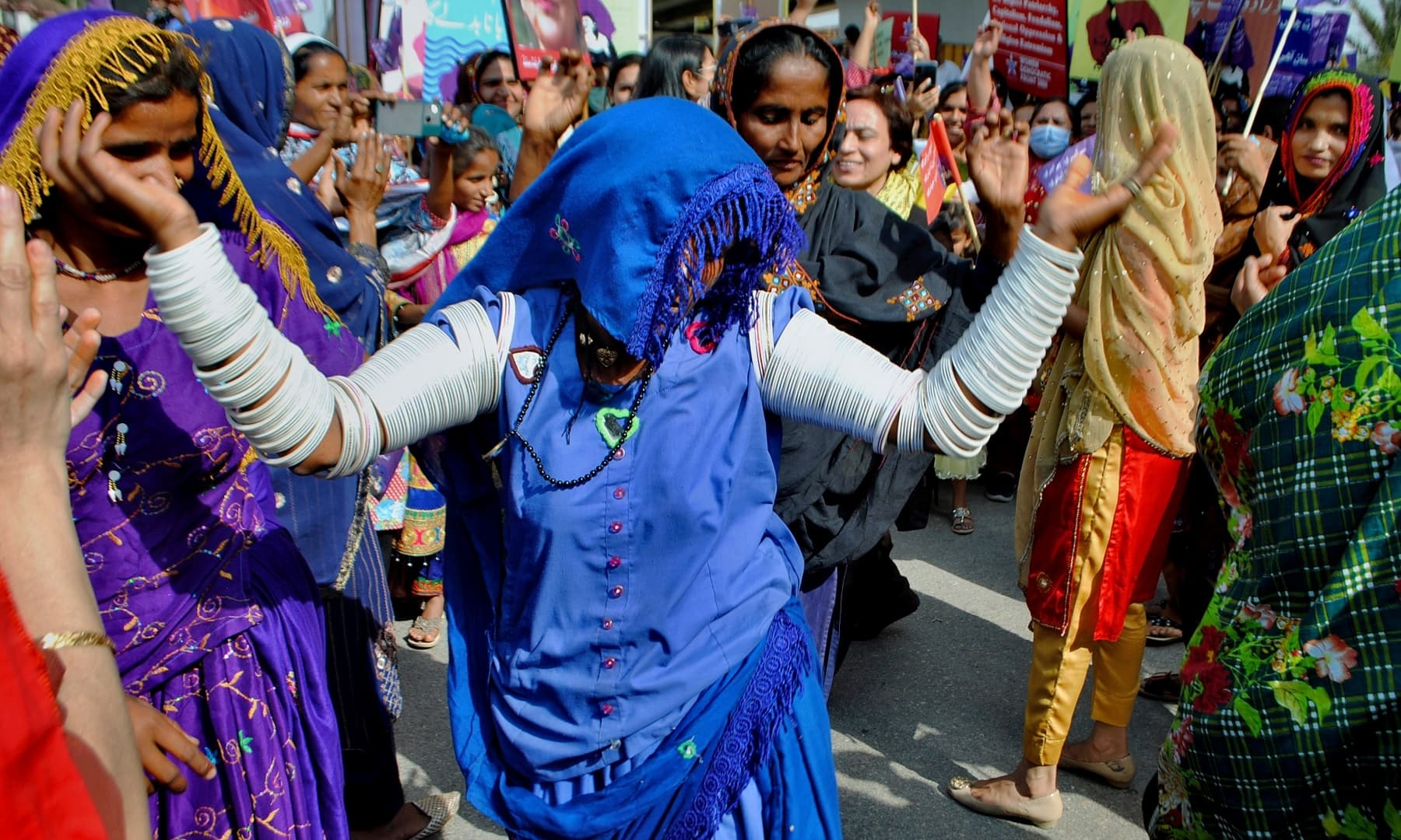 Members of a civil society group dance at a rally to mark International Women's Day, in Hyderabad, Monday. — AP