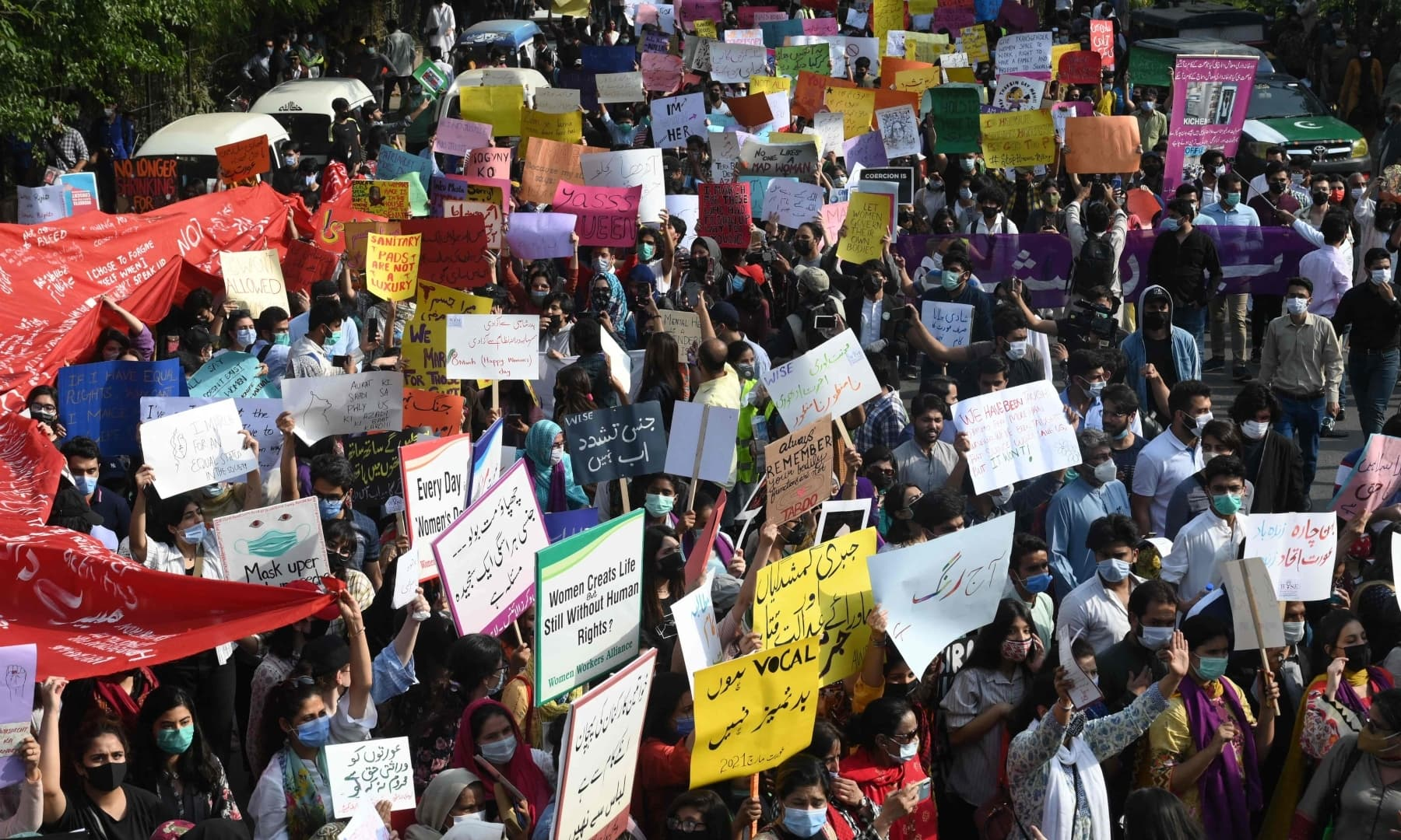 Participants of the Aurat March carry placards during a rally to mark International Women's Day in Lahore on March 8. — AFP