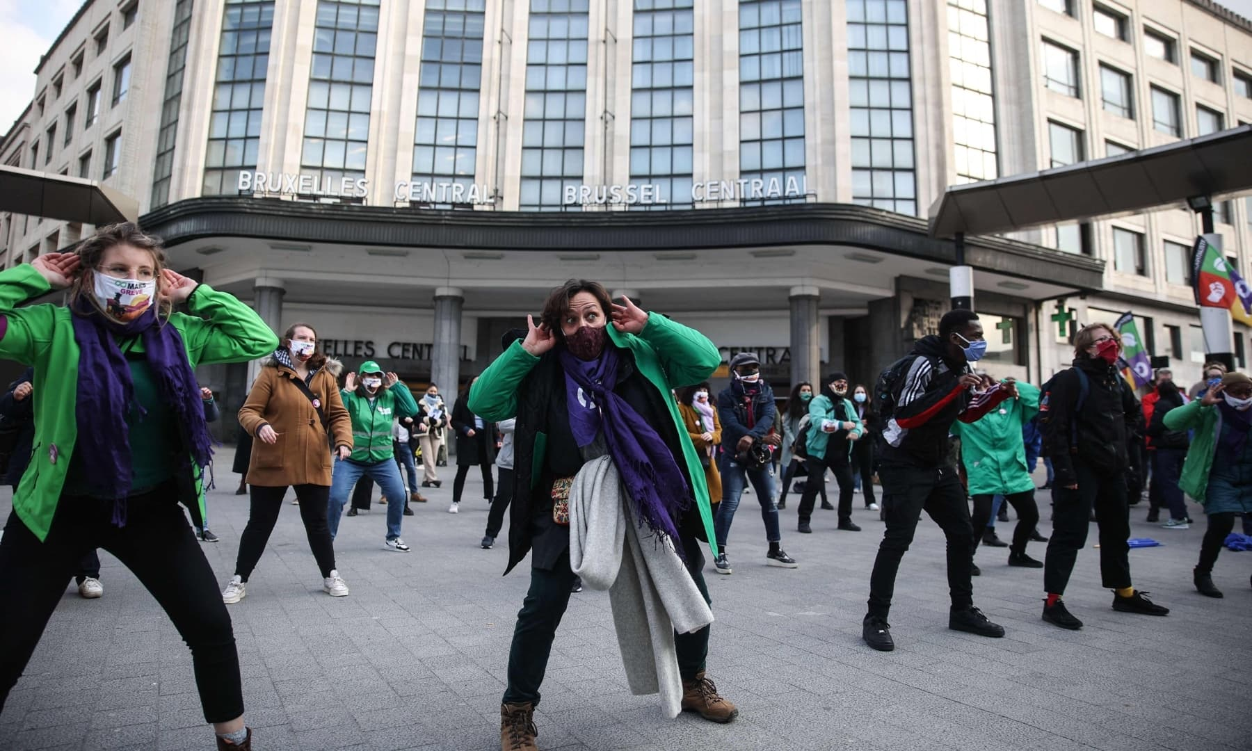 Activists of the CNE workers union participate in a haka for women on the International Women's Day at Brussels' Central Station on March 8. — AFP