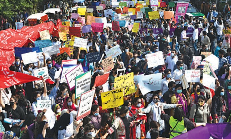 ACTIVISTS of the Aurat March carrying placards hold a rally on Egerton Road to mark the International Women's Day. — White Star