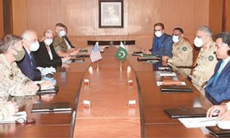 In this file photo, US Special Representative for Afghan Reconciliation Zalmay Khalilzad and Gen Austin Scott Miller, commander of the Resolute Support Mission in Afghanistan, talk to Army Chief Gen Qamar Javed Bajwa at the GHQ. —INP/File