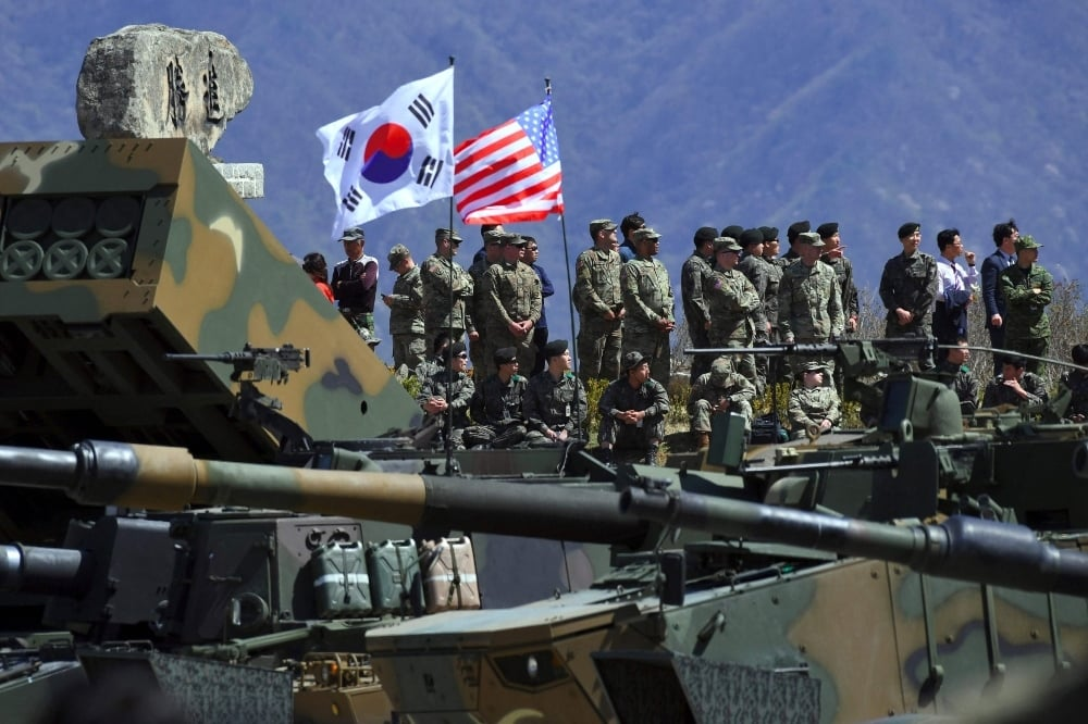 This file photo taken on April 26, 2017 shows South Korean and US soldiers watching from an observation post during a joint live firing drill between South Korea and the US at the Seungjin Fire Training Field in Pocheon. - AFP