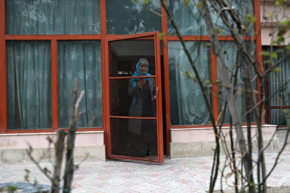Sima Samar, a prominent activist and physician, who has been fighting for women's rights in Afghanistan for the past 40 years, leaves her house for work, in Kabul. - AP