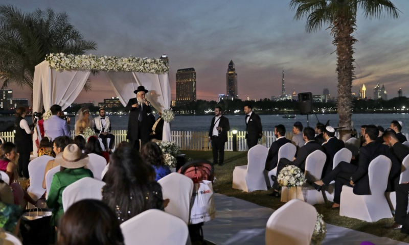 A rabbi officiates under a traditional Jewish wedding canopy during marriage ceremony of the Israeli couple Noemie Azerad, left seated under the canopy, and Simon David Benhamou, at a hotel in Dubai, United Arab Emirates, December 17, 2020 — AP/File