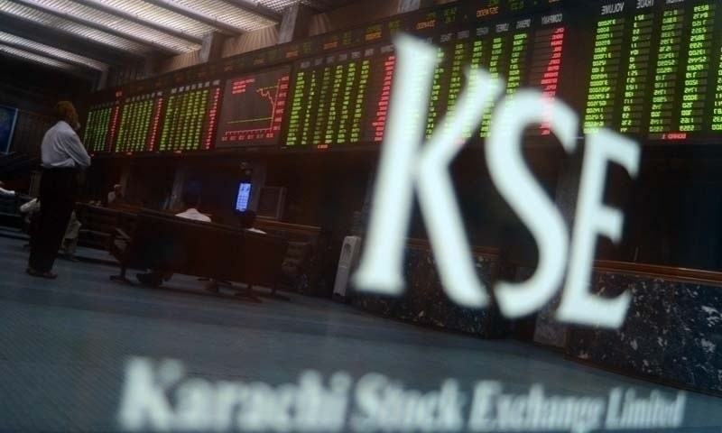 Pakistani stockbrokers watch the latest share prices on a digital board during a trading session at the Karachi Stock Exchange (KSE) in Karachi on May 28, 2013. — AFP/File