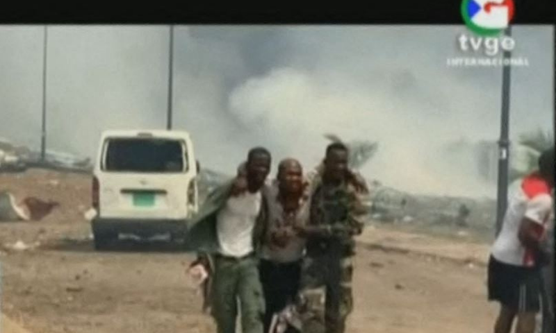 This video grab obtained by AFPTV from TVGE on March 7 shows an injured man being assisted by soldiers in Bata, Equatorial Guinea. — AFP