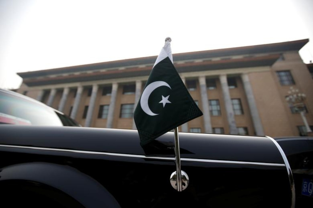 A car with a Pakistani flag waits for Pakistani Minister Imran Khan outside the Great Hall of the People during his visit in Beijing, China, November 3, 2018. — Reuters