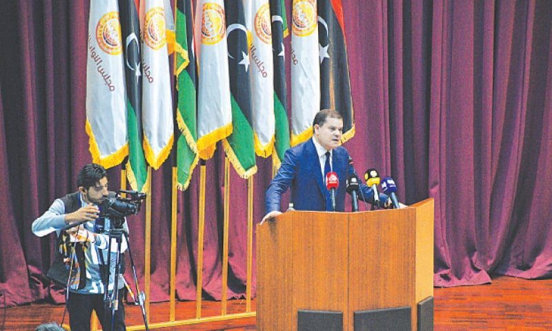 PRIME Minister-designate Abdul Hamid Dbeibah addresses the Libyan parliament in Sirte.—AP
