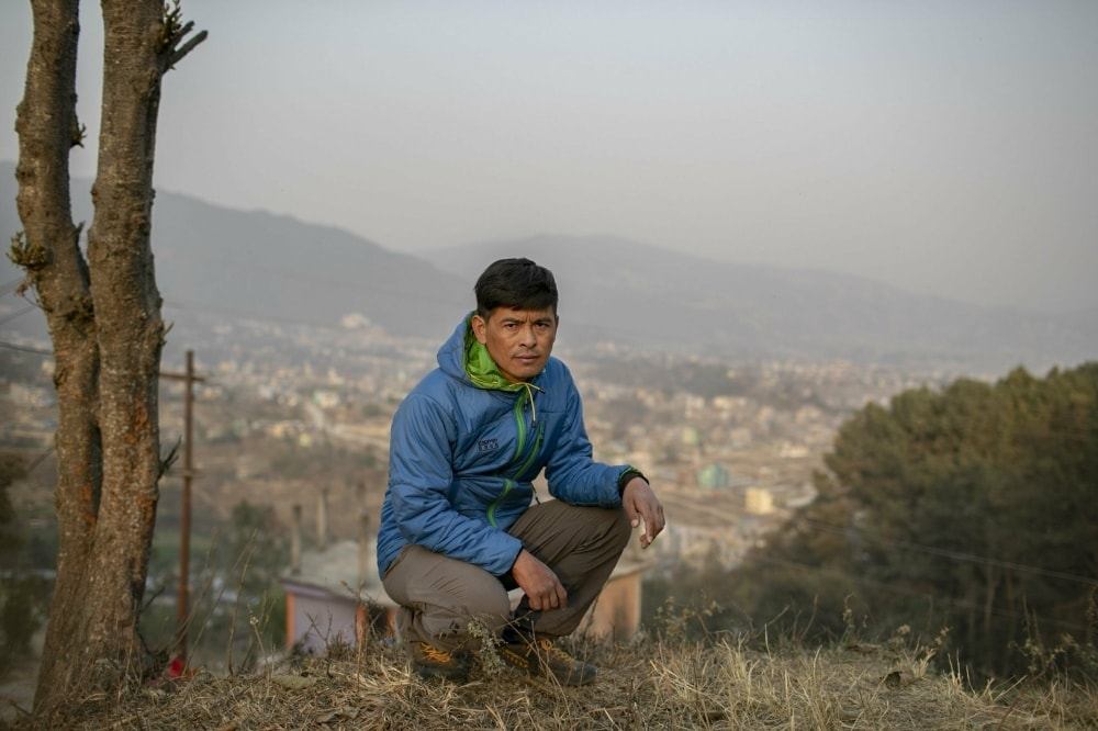 Pasang Rinzee Sherpa, 33, mountain guide poses for a photograph in Kathmandu, Nepal, Wednesday, March 3. — AP