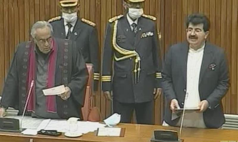 Sadiq Sanjrani takes oath after being elected the new Senate chairman on Friday. — DawnNewsTV
