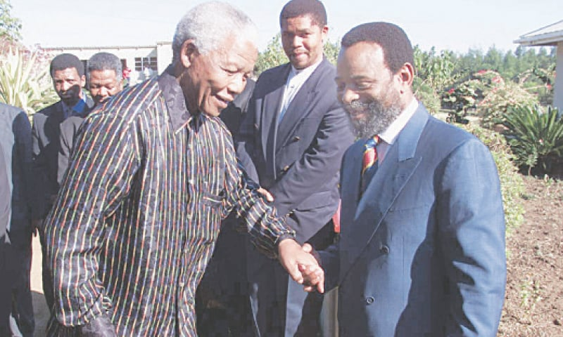 GOODWILL Zwelithini (right) photographed with South African President Nelson Mandela in this June 12, 1999, file photo.—AFP