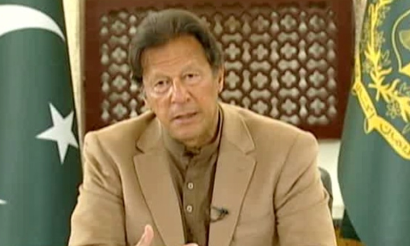 In this file photo, Prime Minister Imran Khan answers people's questions via telephone. — DawnNewsTV/File