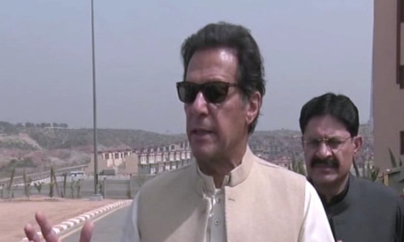 Prime Minister Imran Khan speaks to reporters after the inauguration ceremony in Islamabad. — DawnNewsTV