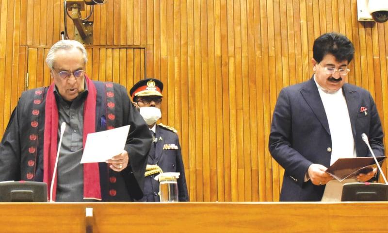 Presiding officer, Senator Syed Muzafar Hussain Shah administering oath to Sadiq Sanjrani   White Star