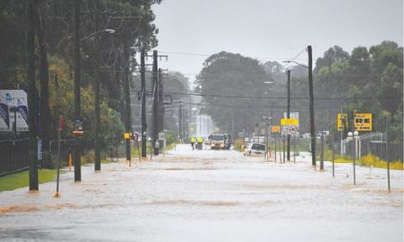 A main road of a residential area flooded during heavy rain in western Sydney on Saturday. — AFP