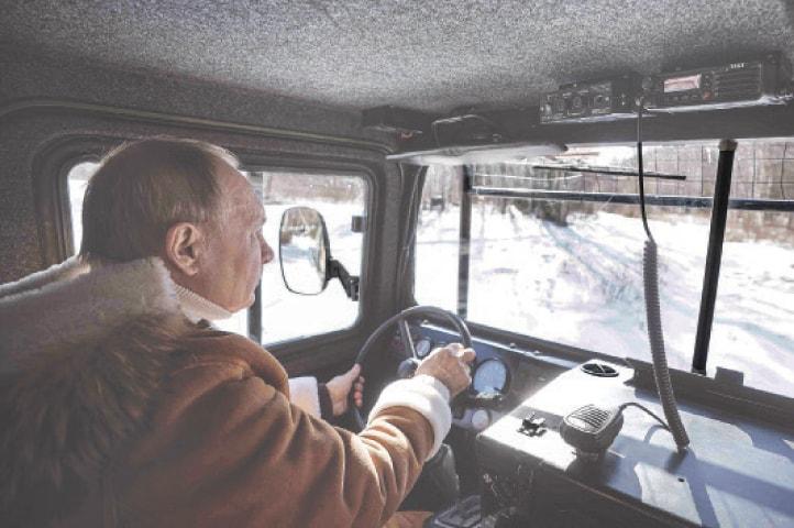 PRESIDENT Putin drives an all-terrain vehicle in a taiga forest in Siberia.—AP