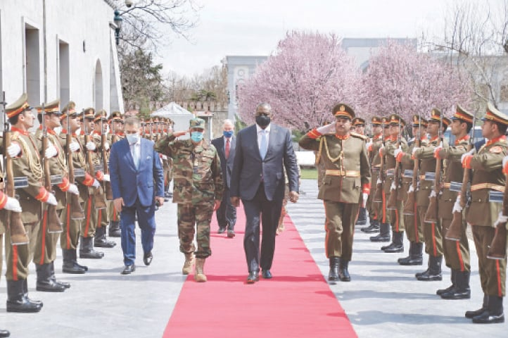 KABUL: US Defence Secretary Lloyd Austin reviews a guard of honour at the presidential palace on Sunday.—AP