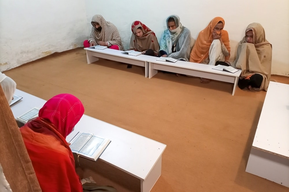 A group of transgender women learn the Holy Quran at Pakistan's first transgender only madrassah in Islamabad. — Reuters