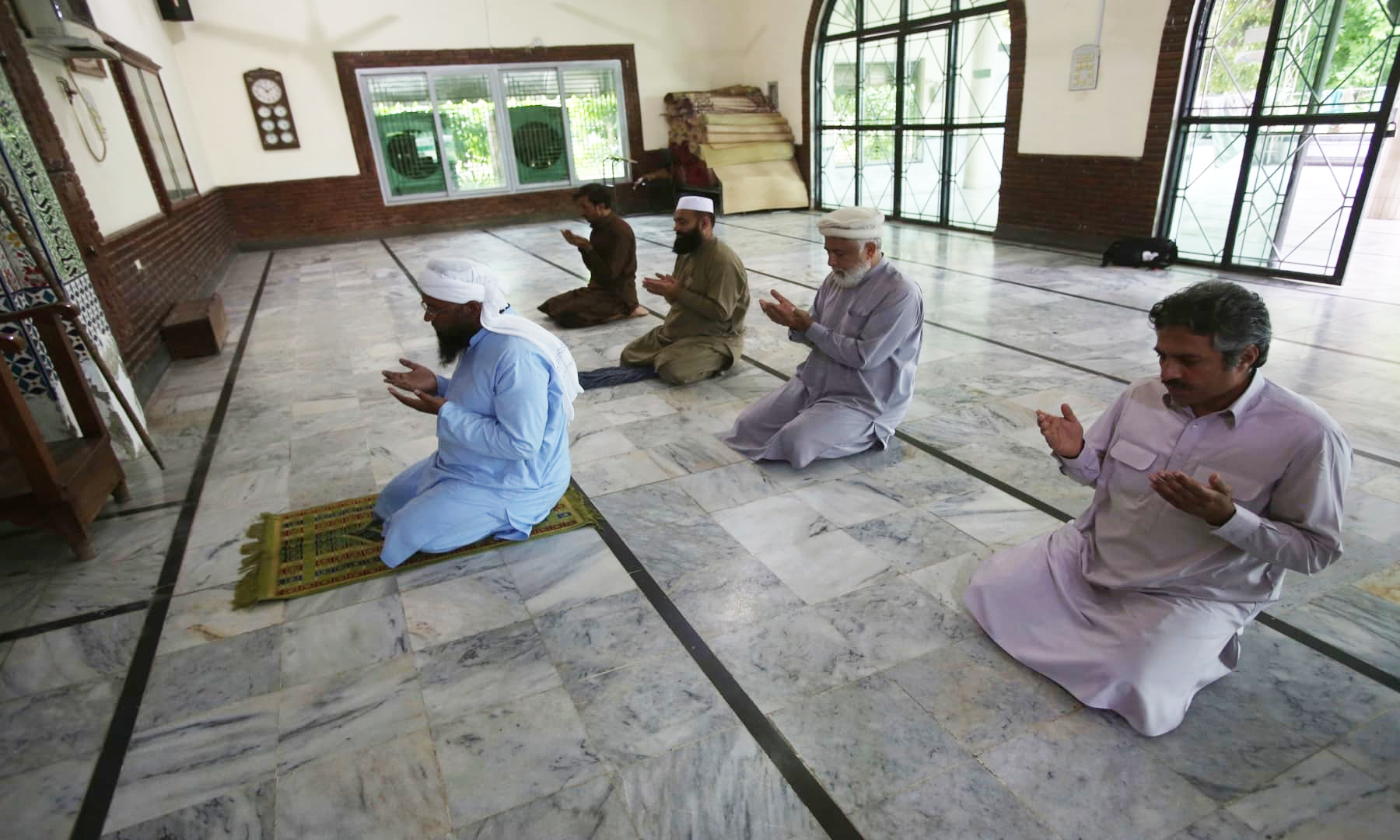 Five people attend Friday prayers at a mosque in Peshawar, maintaining distance as per the directives of the government. — AP/File