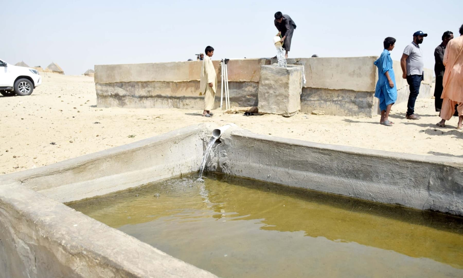 Water is transferred to a storage tank in Achhro Thar, Khipro, Sindh. — Photo by Umair Ali