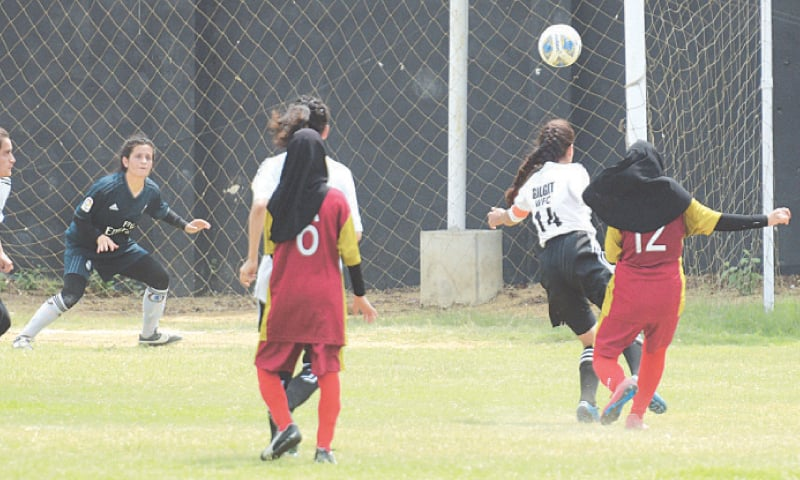 ZOHRA Nasir (R) of Hazara Girls Football Academy shoots to score the winner during the National Women's Football Championship match against Gilgit Women's FC at the KMC Stadium on Tuesday.—Tahir Jamal/White Star