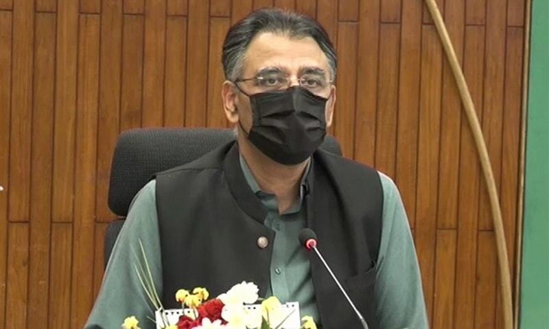 Federal minister Asad Umar addresses a press conference on Friday. — DawnNewsTV