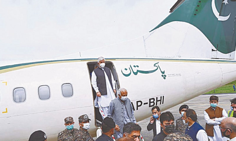 DIGNITARIES alight from the PIA aircraft after it landed at the Saidu Sharif airport. — APP
