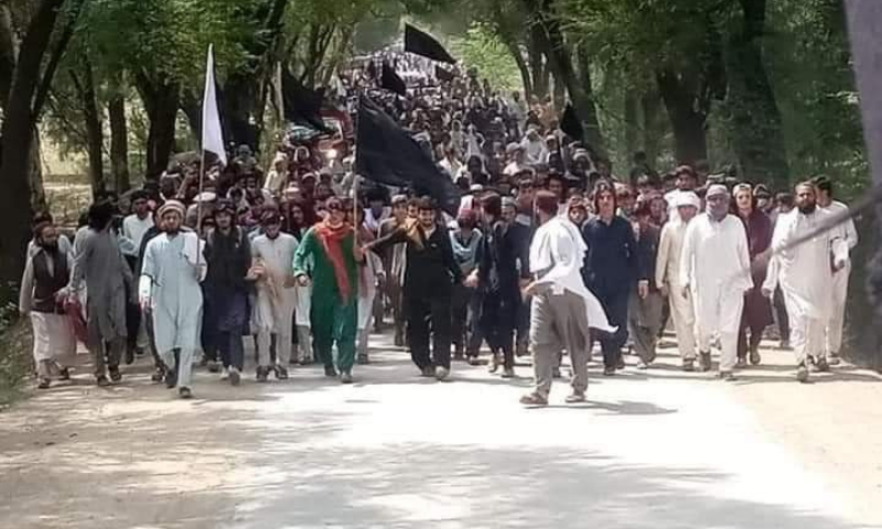 Protesters from the Janikhel area of Bannu are seen during their march. — Photo by Sirajuddin