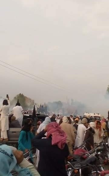 A cloud of smoke is seen after tear gas shelling by police in Bannu. — Screengrab