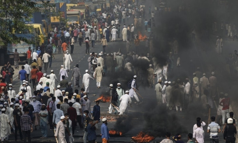 Activists of Bangladesh Islamist group Hefazat-e-Islam, burn tires to block traffic on the Dhaka Chittagong highway as they enforce a daylong general strike in Narayanganj, Bangladesh, March 28. — AP