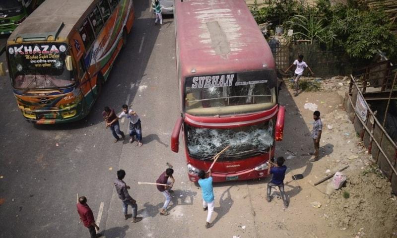 Activists of Bangladesh Islamist group Hefazat-e-Islam, vandalise buses as they enforce a daylong general strike in Narayanganj, Bangladesh, March 28. — AP