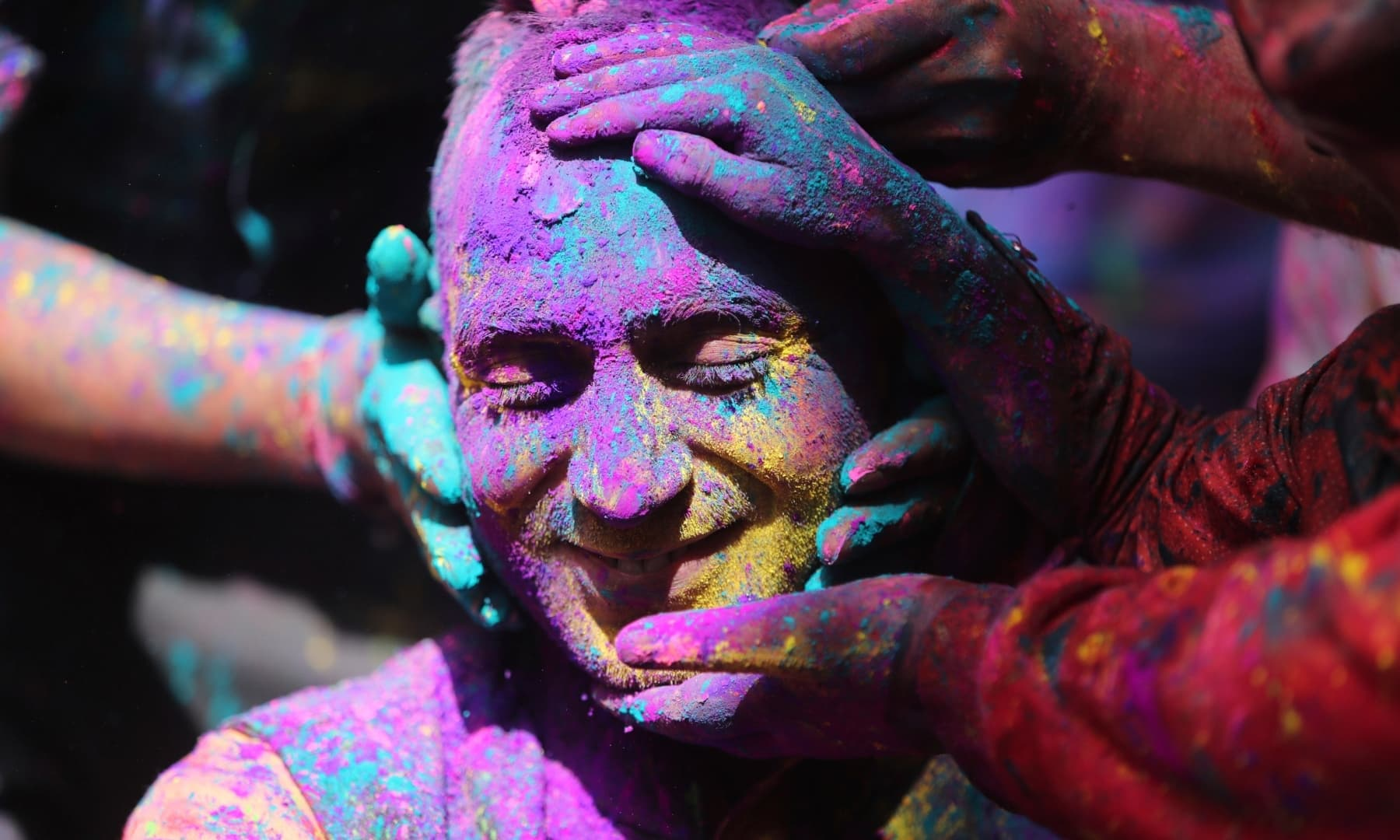 Indians smear coloured powder on each other as they celebrate Holi in Indian-occupied Jammu, Sunday, March 28. — AP