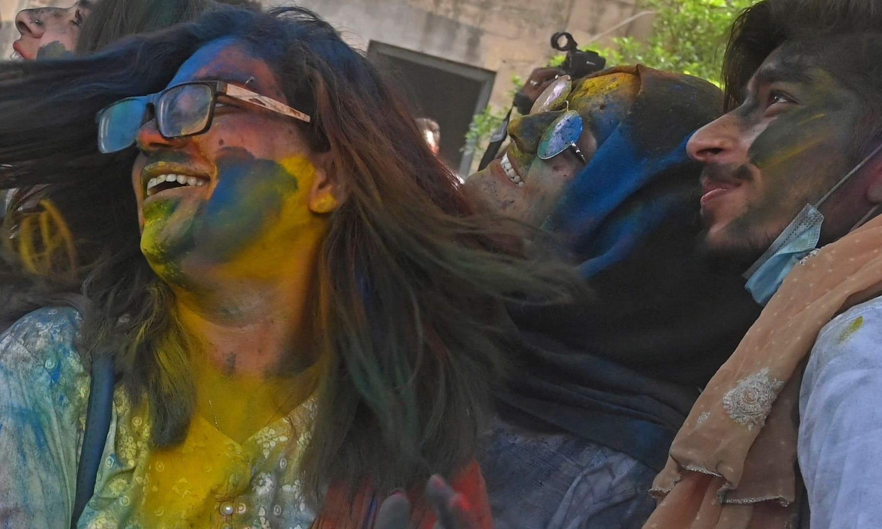 Revellers play with 'Gulal' during Holi celebrations in Lahore on March 28. — AFP