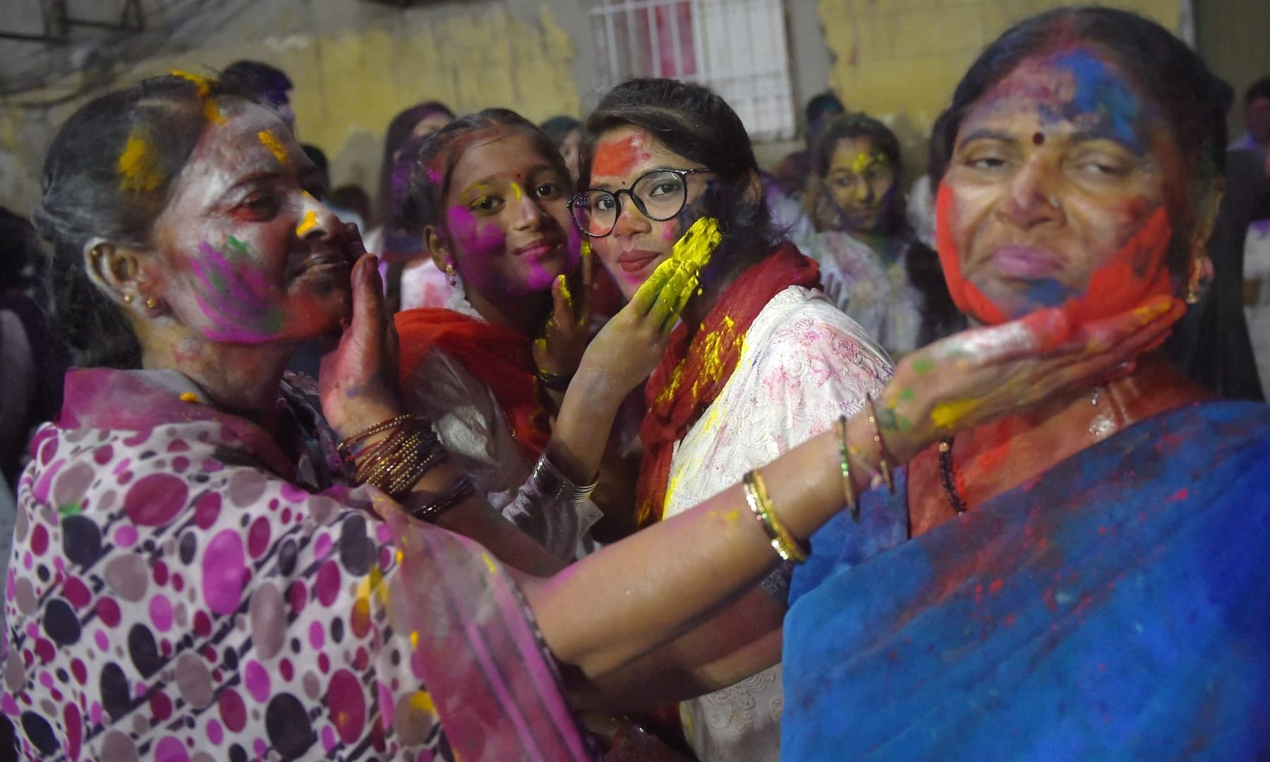 Revellers play with 'Gulal' during Holi celebrations in Karachi on March 28. — AFP