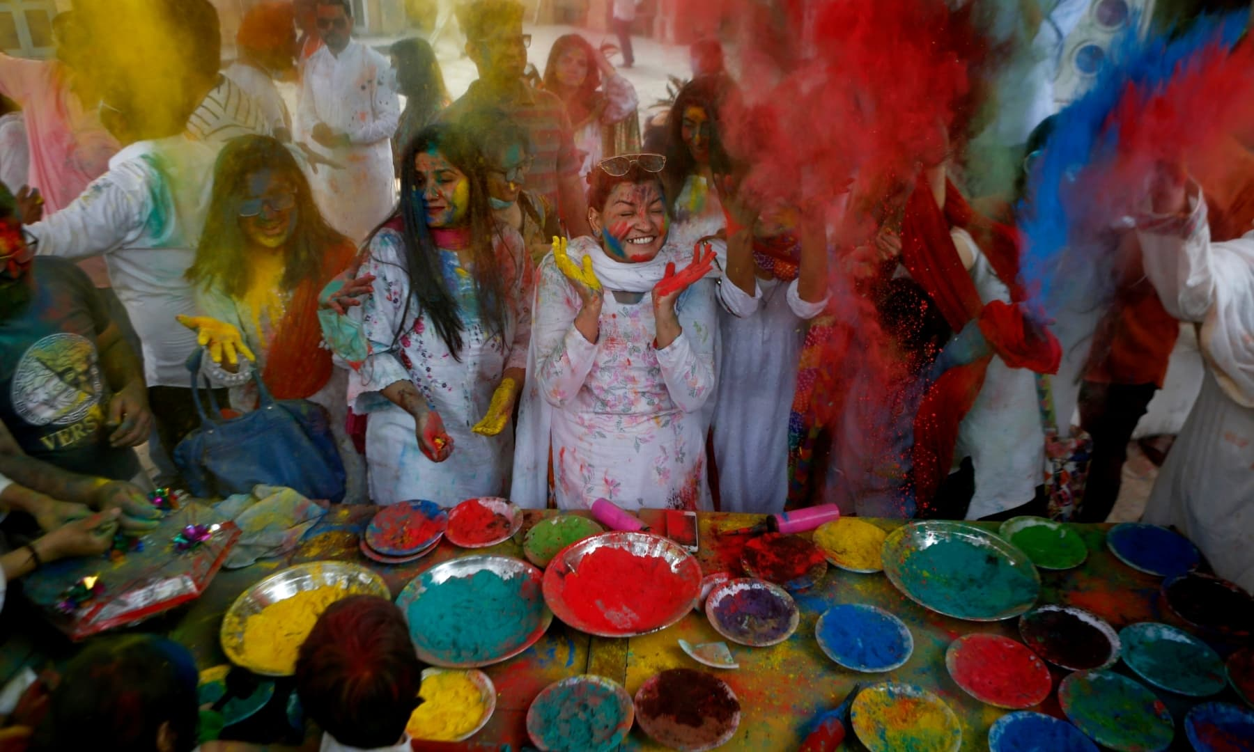 Revellers celebrate Holi at a temple in Lahore, Sunday, March 28. — AP