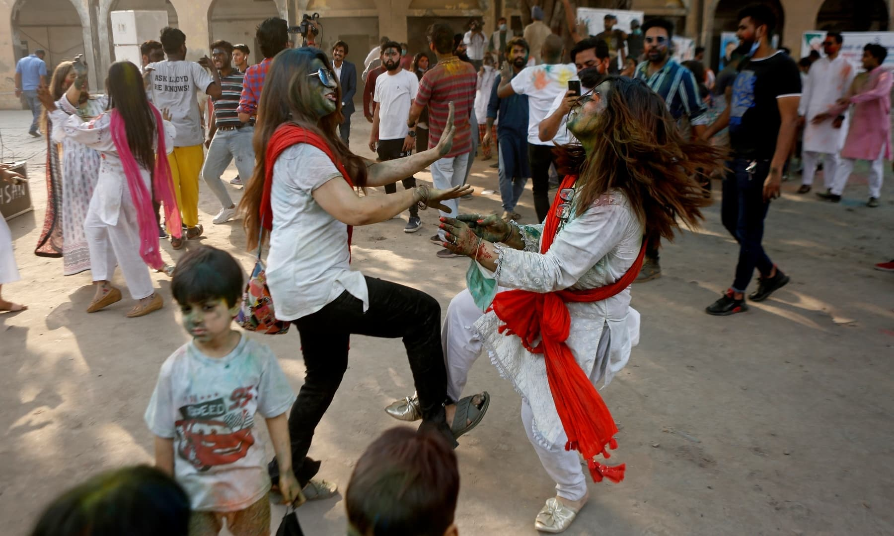 Pakistanis dance to celebrate Holi at a temple in Lahore, Sunday, March 28. — AP