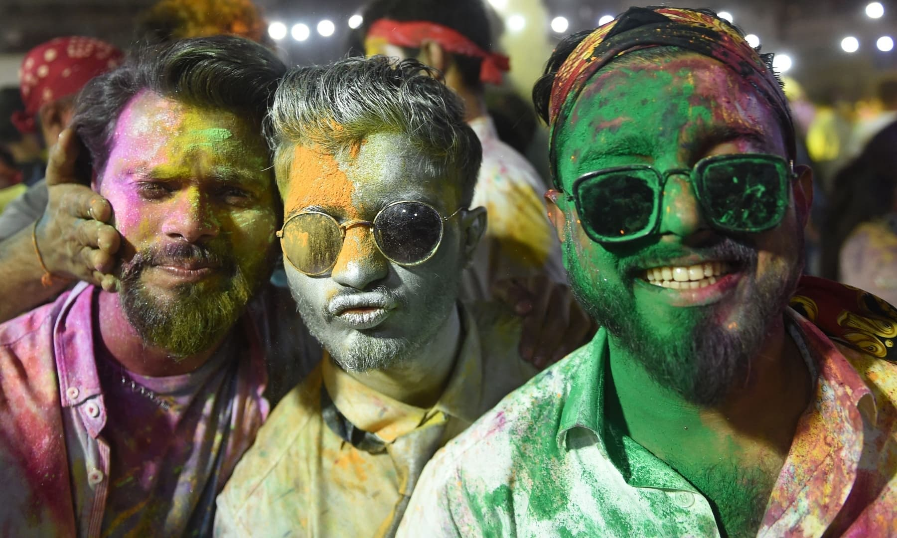 Revellers play with 'Gulal', a coloured powder used in Holi celebrations, in Karachi on March 28. — AFP