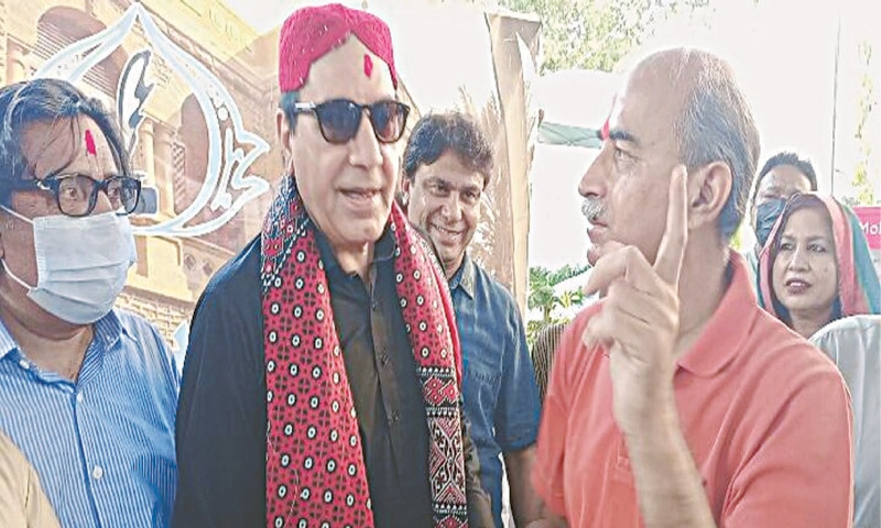 DR Jaipal Chhabria with Javed Sheikh celebrate Holi at the press club on Sunday.—Photo by writer